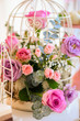 floral arrangement of flowers, bird cage with flowers - 262170837