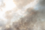 Clouds of black smoke rise against the sky.