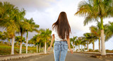 Slim young woman and palms background  - 262195215