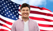 Quadro independence day and people concept - smiling young man over flag of united states of america on background