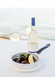 Dish from mussels against the background of the sea