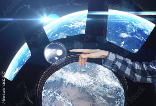 persons hand touch water bubble in the space craft, elements of this image furnished by nasa b