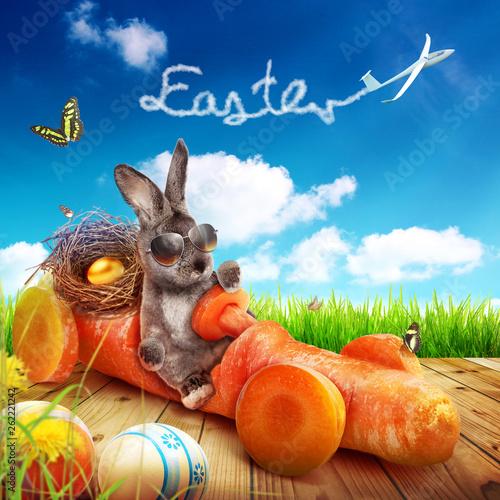 Leinwandbild Motiv Osterhase unterwegs zum Osterfest!