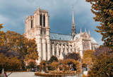 PARIS, FRANCE - JULY 2014: Exterior view of Notre Dame with tourists. This is the most visited landmark in France - 262228822