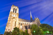 canvas print picture - Notre Dame Cathedral facade against a beautiful blue sky at night, Paris - France
