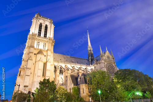 canvas print picture Notre Dame Cathedral facade against a beautiful blue sky at night, Paris - France