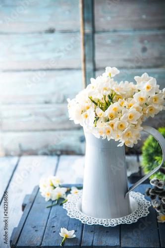 Spring flowers on wood © mythja