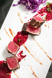 gourmet seared tuna in black pepper crust with beetroot coulis