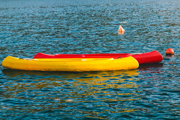 two kayaks red and yellow in water