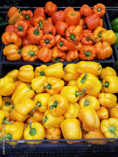 Orange ando yellow bell peppers, natural background - 262255671