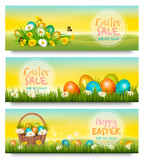 Three Easter Sale banners. Colorful eggs in green grass and spring flowers. Vector.