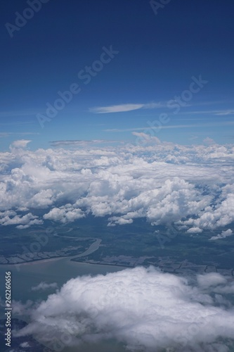 View of the sky and the blue sea from the plane's window - 262260656