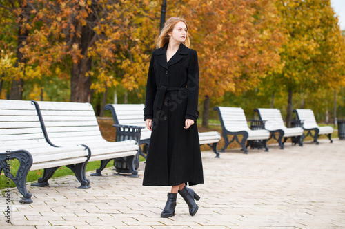 canvas print picture A beautiful blond girl in an autumn park