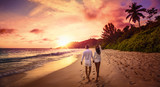 Young Happy Lovers on Beach Sunset