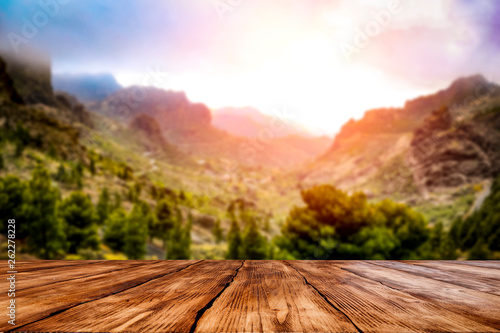 Desk of free space and summer mountains landscape