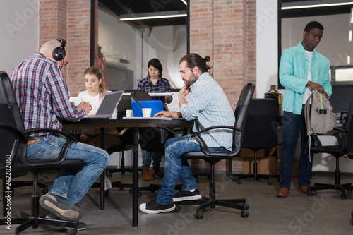 Young adults focused on work in office