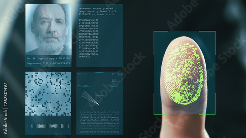 Futuristic digital processing of fingerprints as man holds his hand against a modern fingerprint scanner. Futuristic digital technology and transparent citizen concept. - 262301497