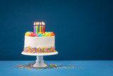 Colorful Birthday Cake over Blue