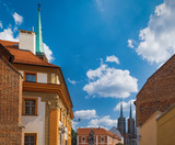 View of Katedralna Street with its beautiful architecture located in historical center of Wroclaw, Poland. Cathedral of St John the Baptist in the background.