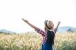 Woman farmer with barley field harvesting season