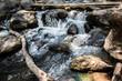 Leinwanddruck Bild - Waterfall in the nature and stone background