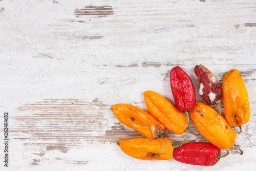 Old, moldy and wrinkled peppers. Unhealthy, decompose, spoiled vegetable. Copy space for text - 262404682