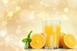 canvas print picture - Orange juice and slices of orange on background