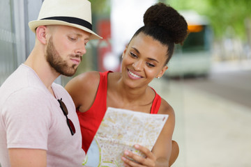 young couple studying a map