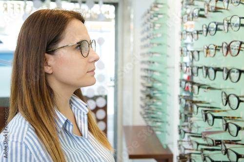 woman browsing a display of eyeglasses © auremar