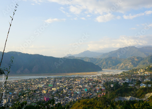 village Jaigaon, West Bengal, India in the Himalayan mountain valley near Bhutan India border with view of Himalayan foot hills and river Torsha  © Kedar