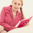 Woman relaxing in bed reading book