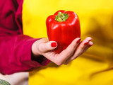 Woman holding red bell pepper