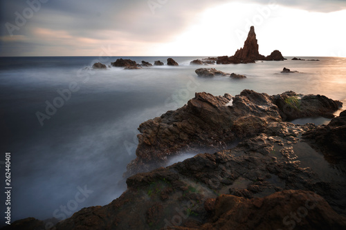 Spain, Almería, Cabo de Gata, Sirens Reef (Arrecife de las sirenas) - Long exposure on sunset, sea and silk effect on the water - 262440401