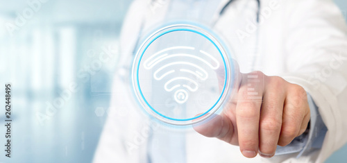 canvas print picture Doctor holding Wifi icon with stats and binary code 3d rendering