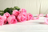 Bouquet of roses on a wooden background