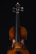 top view of classical wooden violoncello isolated on black
