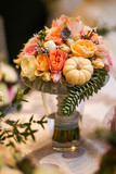 Beautiful bouquet of flowers with pumpkins