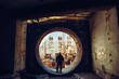 canvas print picture - Man traveller inside round door or gate of abandoned nuclear rector or generator room in ruined and destroyed Nuclear Power Plant