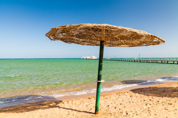 Parasol on the sandy beach of the Red Sea. Egypt