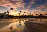 Beautiful romantic sunset over a sandy beach and palm trees. Egypt. Hurghada - 262484012