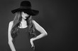 Retro style portrait of beautiful woman model in hat. Black and white photo