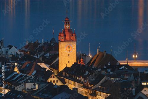 canvas print picture Beleuchteter Turm des Rathauses von Luzern, Schweiz