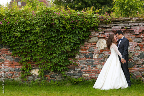 canvas print picture Beautiful wedding couple posing in park