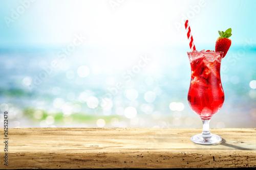 Leinwandbild Motiv Summer drink on desk and sea landscape