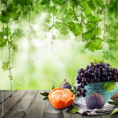 Fruit on wooden table. Grapes morning background - 262524401