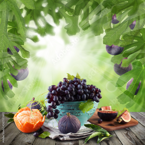 Fruit on dark wooden table with green background. Natural morning dessert - 262533602