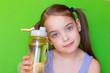 Leinwandbild Motiv A child holds a bottle of water.
