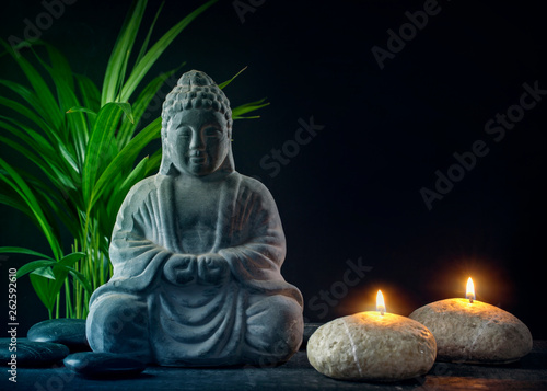 Buddha statue ,towels and candles © Elena Schweitzer
