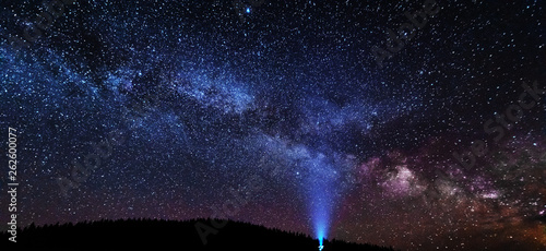 Fantastic starry sky with galaxy Milky way over mountainous masses of Ukrainian Carpathians