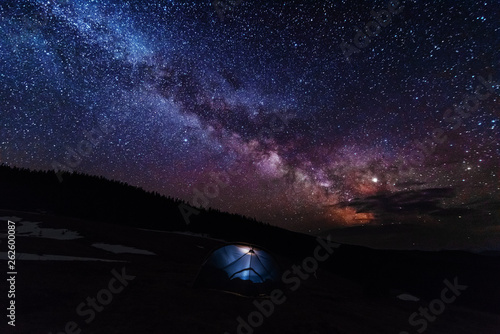 Fantastic starry sky with galaxy Milky way over mountainous masses of Ukrainian Carpathians